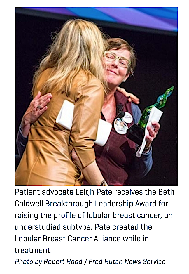 Fred Hutch News Service Photo of LBCA leader Leigh Pate holding a trophy hugging NWMBCC co-chair Lynda Weatherby